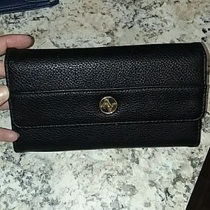 Black wallet with gold logo.
